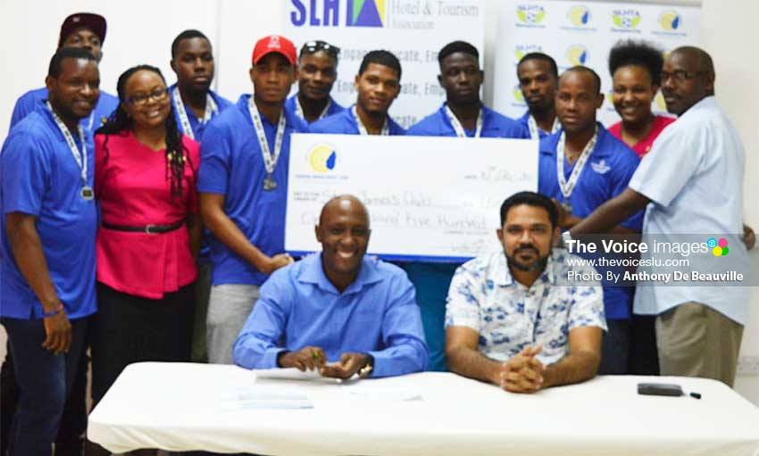 Image: Silver medalist team, St. James Morgan Bay, with manager Frankie Joseph (far right) and SLHTA representatives Roderick Cherry and NooraniAzeez. (PHOTO: Anthony De Beauville)