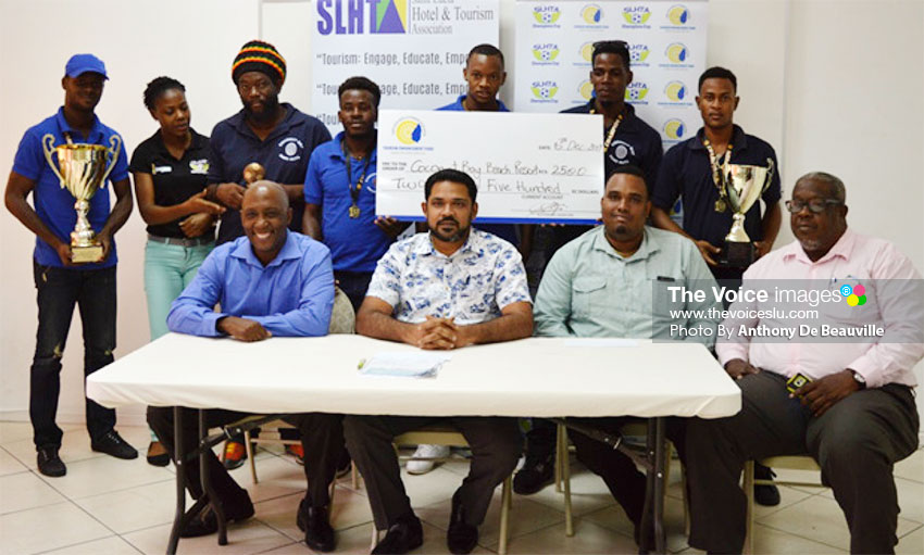 Image: The 2017 SLHTA championship team, Coconut Bay, proudly displaying their winnings with SLHTA officials. (PHOTO: Anthony De Beauville)