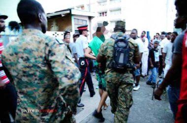 Image: Police take away man