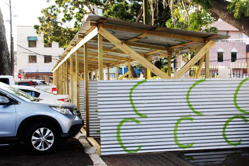 Photo of a wooden structure with the galvanized covering located on the Derek Walcott Square