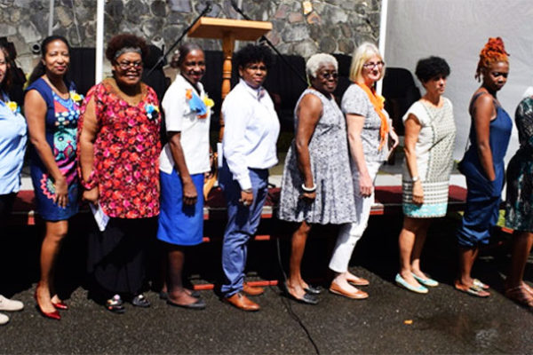 Image: Women Artists: (left to right) Christine Samuel, Jean Mederick, Nicole Edgecombe. Margot Thomas, Shirley Ann Edwards, Keynote Speaker Lizca Bass, AlcinaNolley, Nancy Cole-Auguste, Shay Cozier, Sabrina Romulus, Elizabeth Anthony, Alexandra Grant. Missing: Jeannine Giraudy, Sharon Moise, Aisha Quama Thomas-St. Cyr.