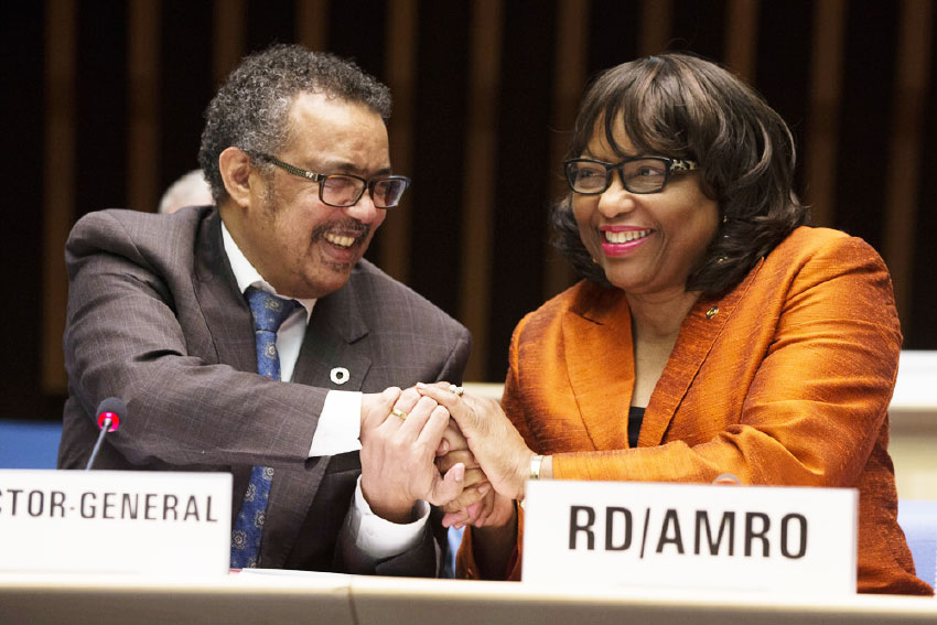 Image of Dr. Carissa Etienne (right).