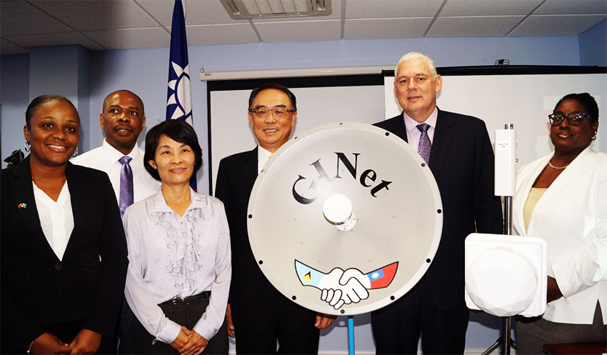 Image From right to left -- P.S. Public Service, Esther Bousquet; PM Allen Chastanet; and Taiwanese Ambassador, Douglas Shen, with GINet team.