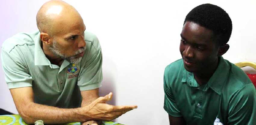 Image of Kimani Melius getting a few words of advice from former West Indies captain and now CWI Director Jimmy Adams during the CWI U19 tournament. (Photo: CWI)