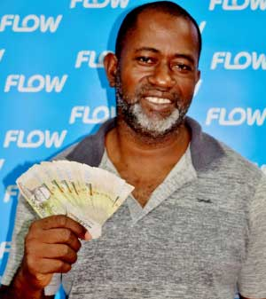 Image of SALCC farm manager Lench Fevrier from Mon Repos, Micoud, a proud Flow customer and a $2000 cash winner!