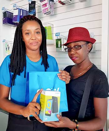 Image of Melissa Nestor, right, winner of the Flow Extra Special Moments competition on Facebook.