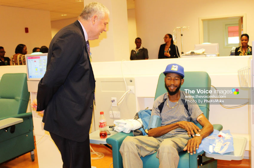 Image of PM Chastanet chatting with a patient on dialysis during a tour of the facility on Wednesday. (PHOTO:PhotoMike).