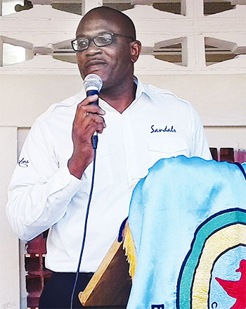 Image of Ryan Matthew addressing students at the Entrepot Secondary School.