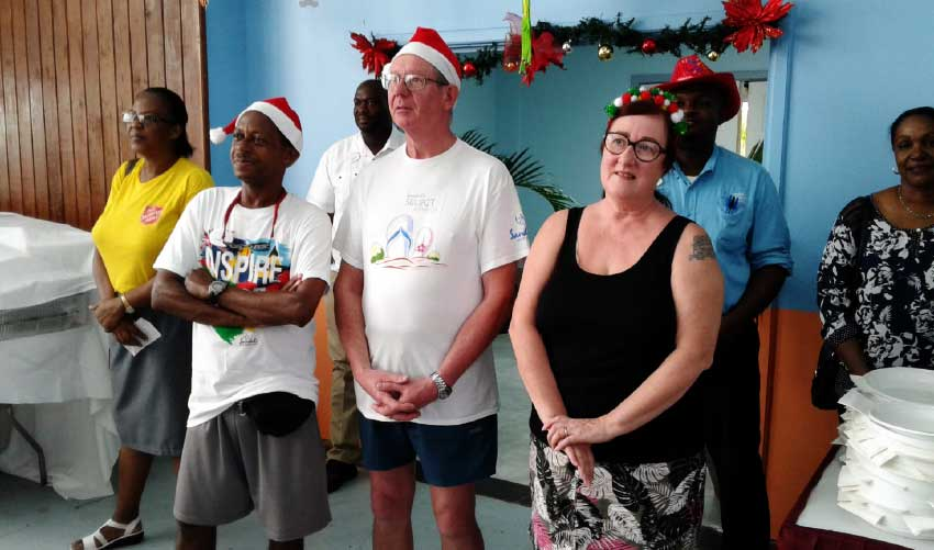 Image: Sandals guests Gordon and Elizabeth Craig join in the Christmas spirit and assist at the Boxing Day lunch.