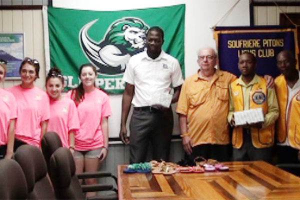 Image: Slippery Rock University officials presenting donation to local representatives.