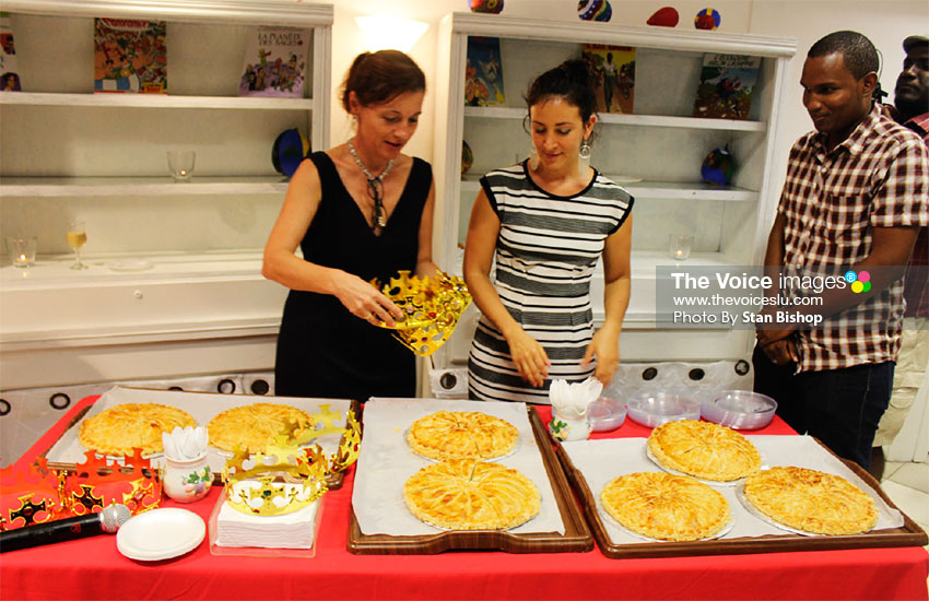 Image: Two Alliance Francaise staffers, left, share the Gallet de Rois. [PHOTO: Stan Bishop]