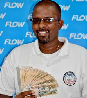 Image of Soufriere Comprehensive mathematics teacher Zial Williams will be counting up his $2000 winnings from Flow!