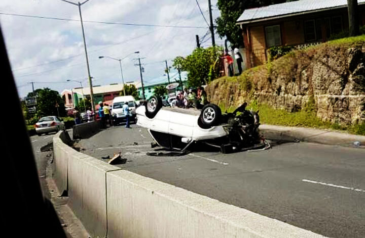 Image of the car flipped onto its roof.