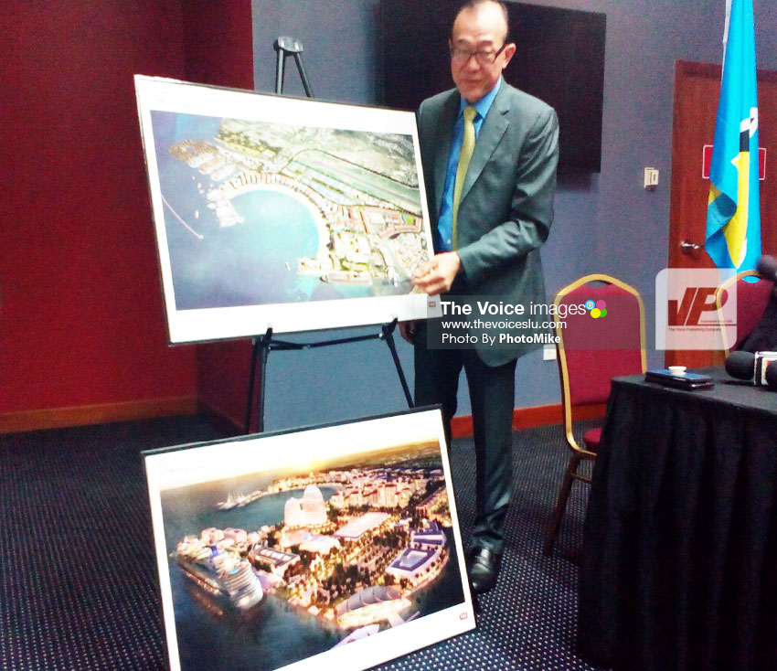 Image of Ah Khing presenting pictorials of what the Il Pirata site will look like after completion of that phase of the Pearl of the Caribbean project. (PHOTO by PhotoMike)