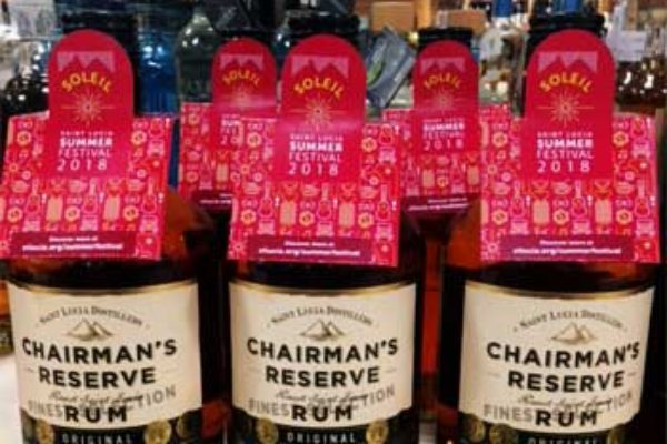 Image: Chairman's Reserve Rum with the Soleil Summer Festivals souvenir custom bottle neck collars.
