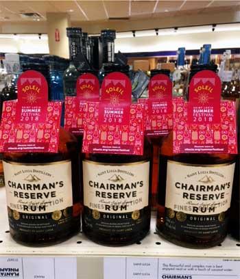 Image: Chairman's Reserve Rum with the Soleil Summer Festivals souvenir custom bottle neck collars.