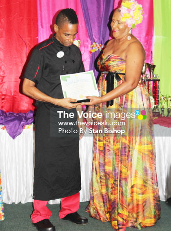 Image: Chef Elias Edward receives his award for being the Most Outstanding in his department. [PHOTO: Stan Bishop]
