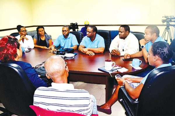 Image: Flow officials and members of the media at the recent breakfast meeting.