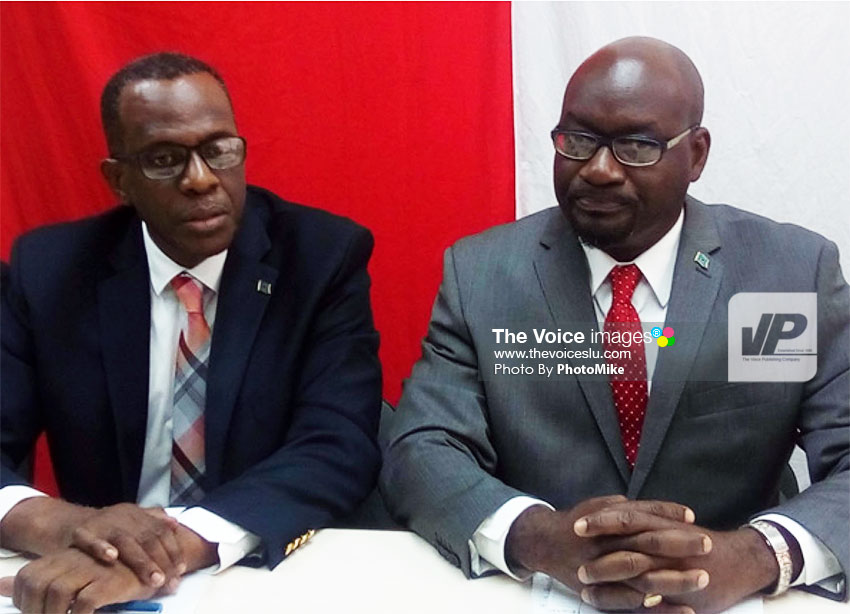 Image of Jn. Baptiste (right) and SLP Political Leader, Philip J. Pierre. (PhotoMike)