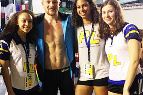 Image of Katie Kyle (third from left) with Great Britian medallist Adam Peatty