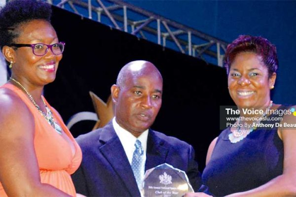 Image: Lightning Aquatic ladies Karetta Crooks Charles (L) and Loyola Edwin (R) receiving the Club of the Year award from Acting Director of Sports Patrick Mathurin. (PHOTO: Anthony De Beauville)
