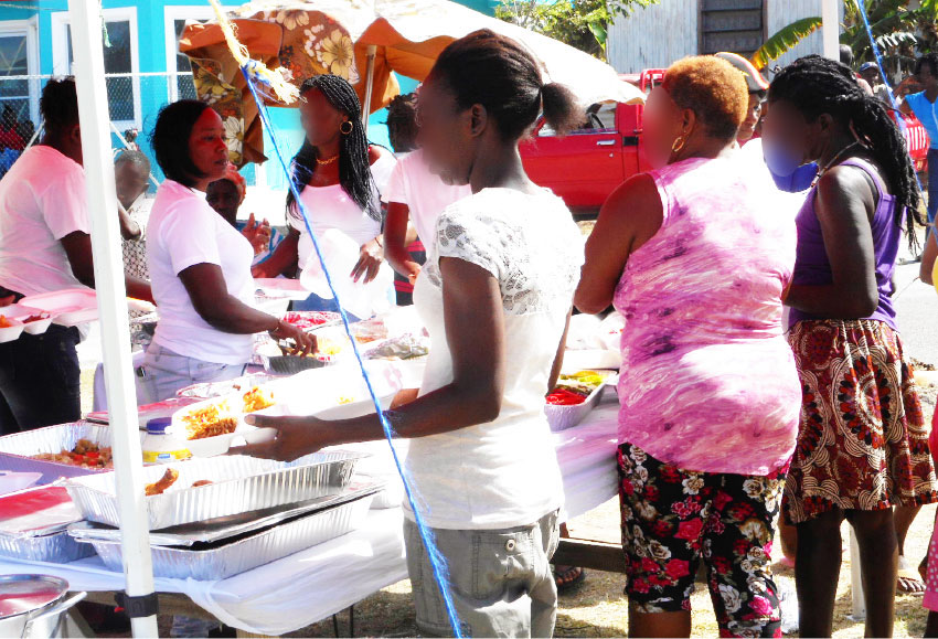 Image of residents of Bruceville being served.