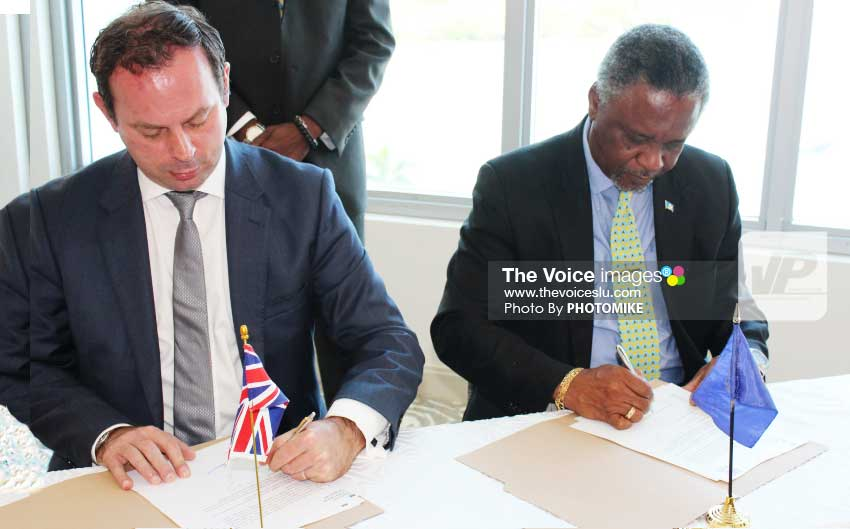 Image: Resident British Commissioner Steve Cready and Home Affairs and National Security Minister Hermangild Francis signing MOU yesterday. [ PHOTO: PHOTOMIKE]