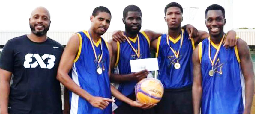 Image: (L-R) SLBF President Leslie Collymore with newly crowned champions Savage Storm - Keegan Preville, Andre Louison, Marlon Samuel and ShamoirJn Baptiste. (PHOTO: SLBF)