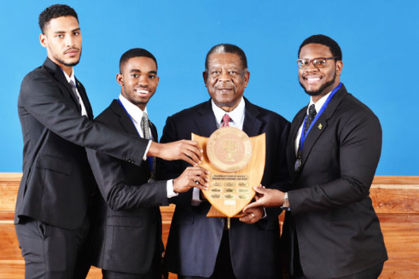 Image: The winning Norman Manley team and the CCJ President.