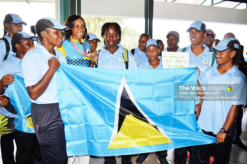 Image: A picture moment for the Commonwealth Games High Jump Champion and Saint Lucia National Senior Women's Cricket Team (Photo: Anthony De Beauville)