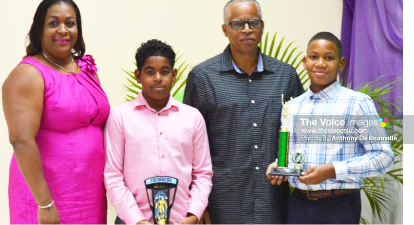 Image: (L-R) Deputy PS Department of Youth Development and Sports – Liota Charlemagne – Mason, Ethan Hazell 2nd place male swimmer of the year; SLASA President – Eddie Hazell and Karic Charles 1st place male swimmer of the year. (PHOTO: Anthony De Beauville)