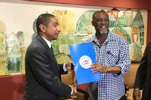Image: Mayor Francis (right) after signing the agreement