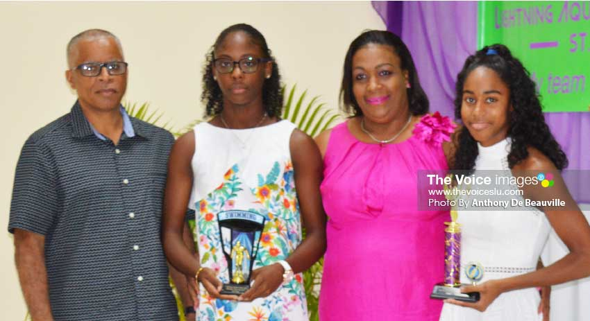 Image: (L-R) SLASA President Eddie Hazel, Naekeisha Louis 2nd place female swimmer of the year, Deputy PS Sports – Liota Charlemagne- Mason, and Naima Hazell 1st place female swimmer of the year. (PHOTO: Anthony De Beauville)