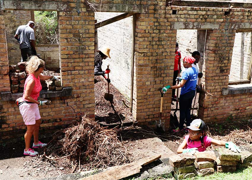 Image: Women and children participating in clean-up