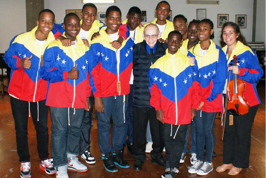 Image: Young Saint Lucian performers with the Venezuelan master musician Jose Antonio Abreu, during one of several encounters.