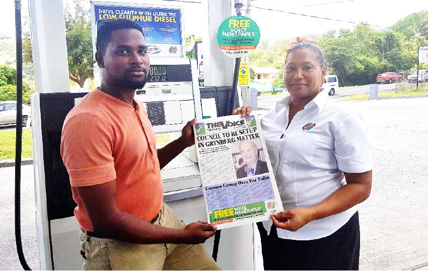 Image: (L-R) A proud Rubis customer collects the VOICE Newspaper from a Rubis representative. (PHOTO:Rubis Saint Lucia)