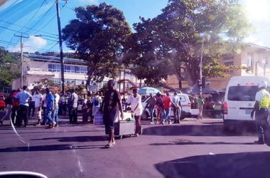 Image: Hoards of curious onlookers after Bullets ripped through the busy Castries City