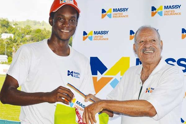 Image: (L-R) Fast bowler and man of the match Dudley Charles picked up 5 for 27; Charles received his man of the match award from Director - United Insurance Agents (Saint Lucia) Limited - Hollis Bristol. (PHOTO: Anthony De Beauville)