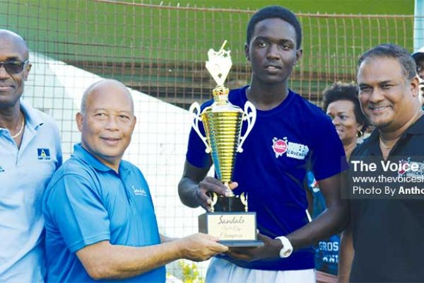 Image: (L-R) SLNCA President, Julian Charles, Sandals Saint Lucia Manager Winston Anderson presenting Gros Islet captain with the championship trophy, while Sandals Regional Public Relations Manager Sunil Ramdeen looks on. (PHOTO: Anthony De Beauville)
