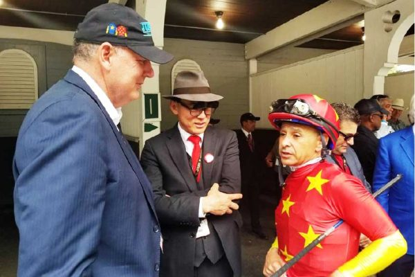 Prime Minister Allen Chastenet pictured here with Teo ah-King (centre) and Triple Crown winning jockey Mike Smith (Credit @ Facebook post of Allen Chastanet)