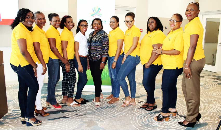 Image of Ladies from 1st National Bank in attendance at the seminar with the Country Manager of FCIS