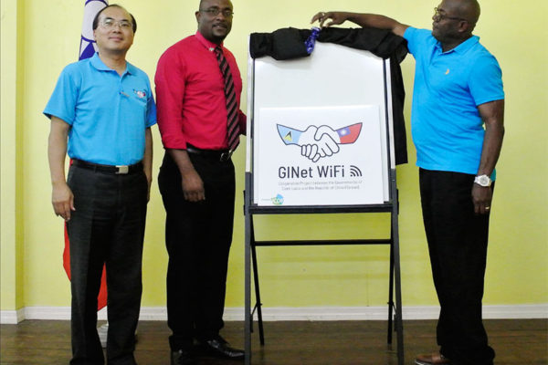 Image of Minister Edmund Estaphane, Hon. Shawn Edward and Mr. Louis Liou, Deputy Counsellor of the Embassy of the Republic of China (Taiwan) together announced the GINet Free WIFI Service Launched in Dennery North.