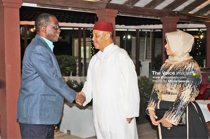 Image of Ambassador Abderrahim greeting Opposition Leader Philip J Pierre Monday night at the reception; Next to the Ambassador is his wife.