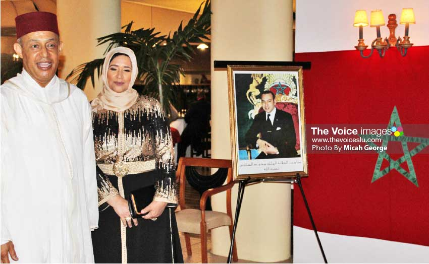 Image of Ambassador Abderrahim and wife next to a portrait of King Mohammed waiting to greet their guests at Monday night's reception.