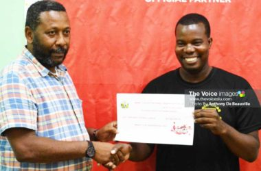 Image: (L-R) SLFA President Lyndon Cooper presenting the 1st place cheque of EC$25,000 to a representative of the Marchand Football League for winning the inaugural Coca Cola Island Cup 2018. (Photo: Anthony DeBeauville)
