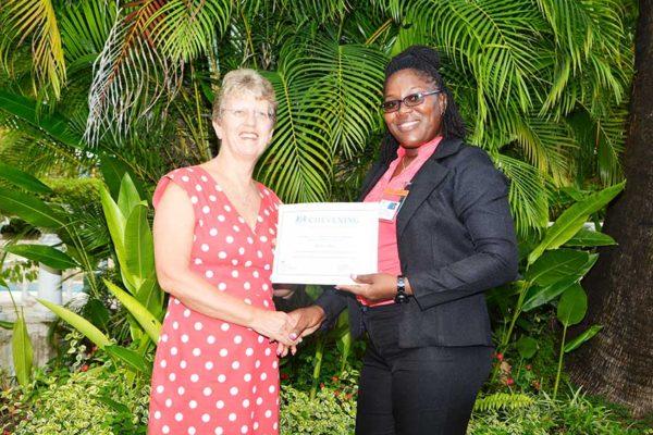 Image of Kenisha Jeffrey receiving scholarship