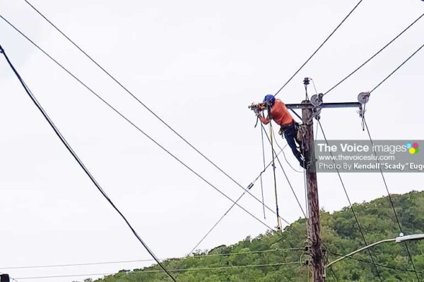 """Image: Electricity was blacked-out on Thursday night and early Friday morning, but LUCELEC crews island-wide ensured all could switch the lights back on by midday yesterday. (PHOTO: Kendell """"Scady"""" Eugene)"""