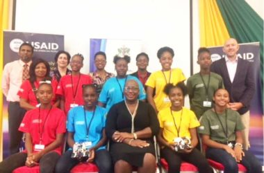 Image: Minister of Education Dr. Gale Rigobert (centre), Kipp Sutton, USAID General Development Office Director (right), along with other Community, Family and Youth Resilience (CFYR) Project officials and participating students.