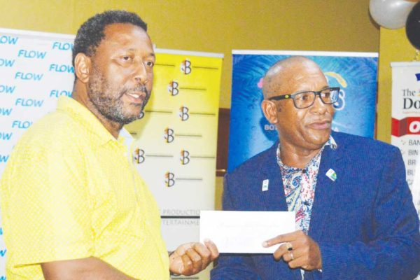 Image: President Lyndon Cooper receiving the $105, 400 cheque