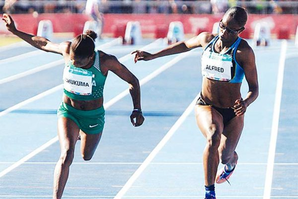 Image: (L-R) Youth Olympic Games Gold Medalist, Nigeria's Rosemary Chukuma (11.17 seconds) and Silver Medalist Saint Lucia's Julien's (11.23 seconds) at the finish. (PHOTO: IAAF)